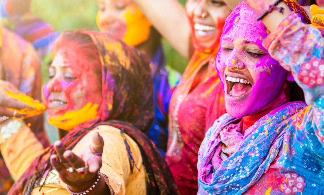 Indian women throwing Holi powder