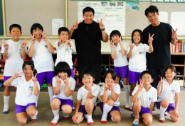 Andrew Kim with his students in Japan