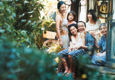 Japanese family sitting in the garden together