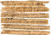 Strips of worn paper with Buddhist text