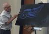 presenter shows Urdu calligraphy